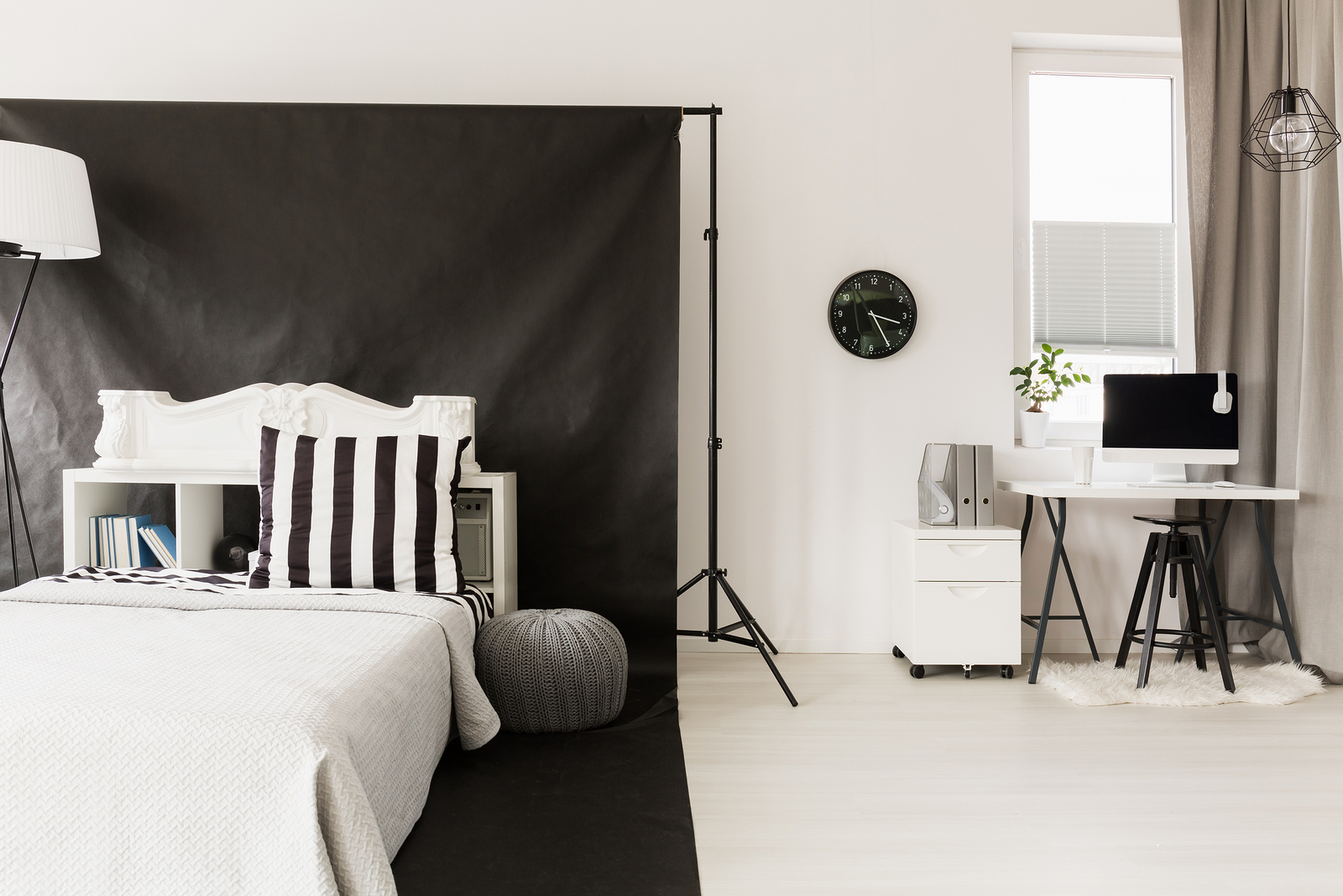 Home interior in black and white with sleeping and office space